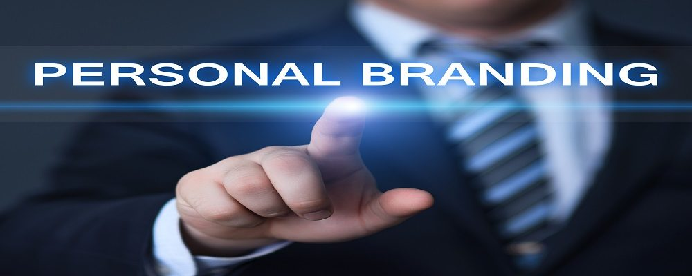 business, technology and internet concept - businessman pressing personal branding button on virtual screens